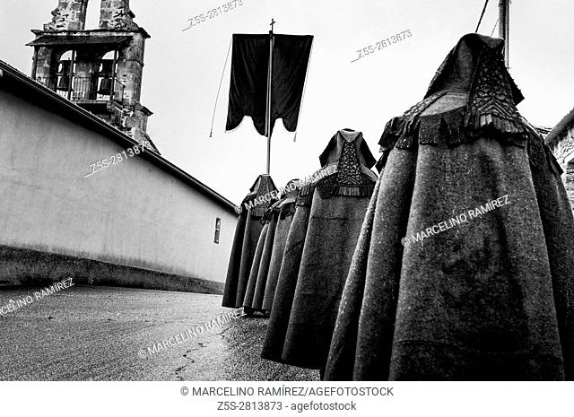 Holy week. On Maunday Thursday members of the Brotherhood of the Cross go in procession, dressed in the brown or 'alistana' coat and arranged in a row of one