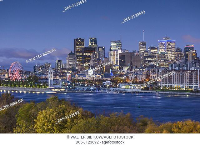 Canada, Quebec, Montreal, elevated city skyline from the St. Lawrence River, dawn