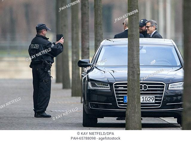 USactor George Clooney (R) has a picture taken of himself and a police officer after he and his wife Amal met with German Chancellor Angela Merkel at the...