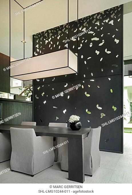 Dining table and cut out wall