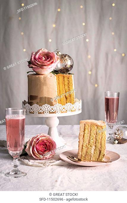 Chiffon cake with roses and sparkling rose wine for Christmas