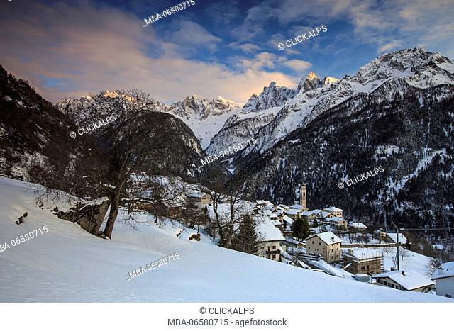 Winter sunset in Soglio with view on Sciore, Pizzo Badile and Cengalo, Soglio, Val bregaglia, Canton of Graubunden, Switzerland
