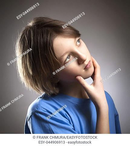 Portrait of a Boy with Brown Hair Thinking