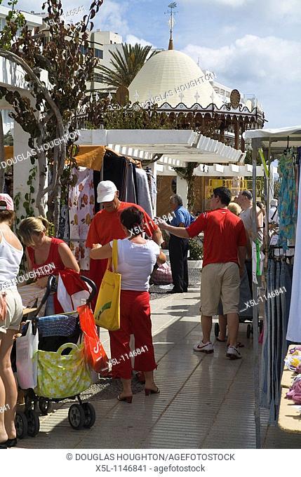 Avenida La Marina ARRECIFE LANZAROTE Tourists shopping at Arrecife market stalls on promenade