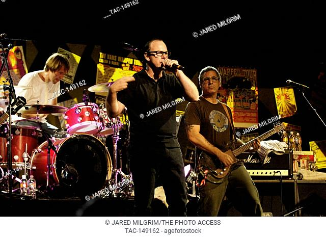 (L-R) Brooks Wackerman, Greg Graffin and Brett Gurewitz of Bad Religion perform at the Vans Warped Tour 15th Anniversary Celebration at Club Nokia on September...