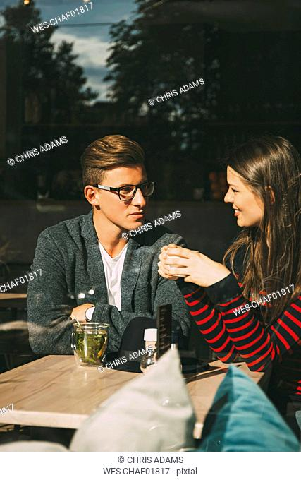 Couple sitting in a coffee shop talking