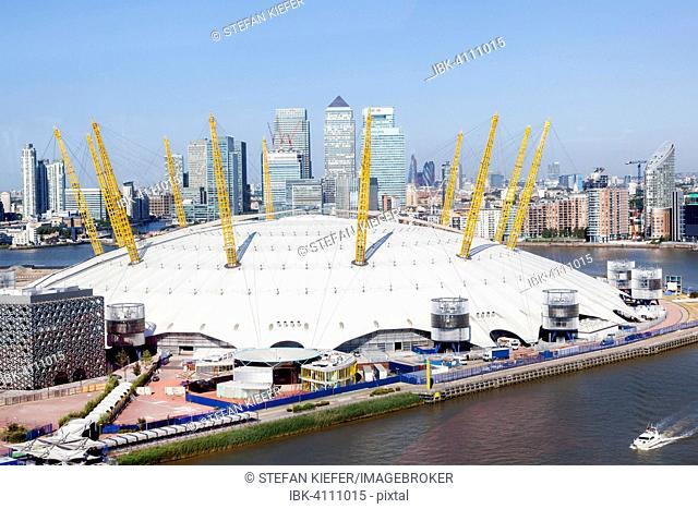 The Dome, Millennium Dome, The O2, with Canary Wharf financial district on the River Thames, London, England, United Kingdom