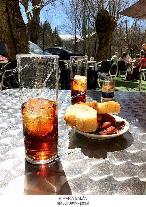 Two glasses of vermouth and tapa in a terrace. Spain