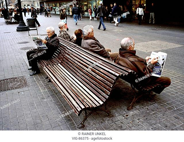SPAIN, BARCELONA, 10.01.2005 City life in Barcelona: Pensioners are sitting on a benc. - Barcelona, SPAIN, 10/01/2005