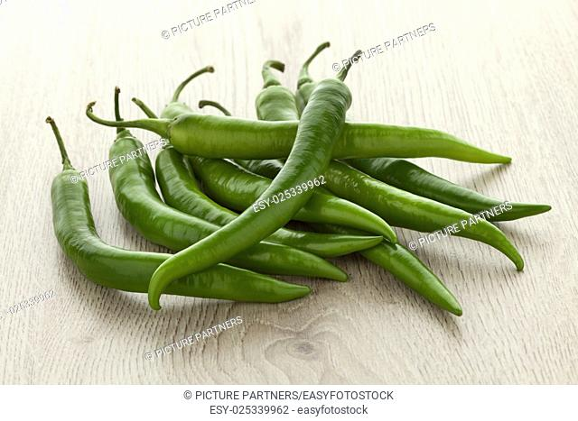 Heap of fresh raw green chil peppers