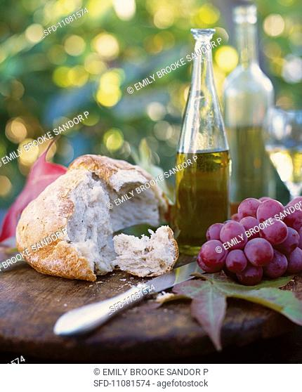 Rustic Picnic with Bread, Grapes and Wine, Outdoors