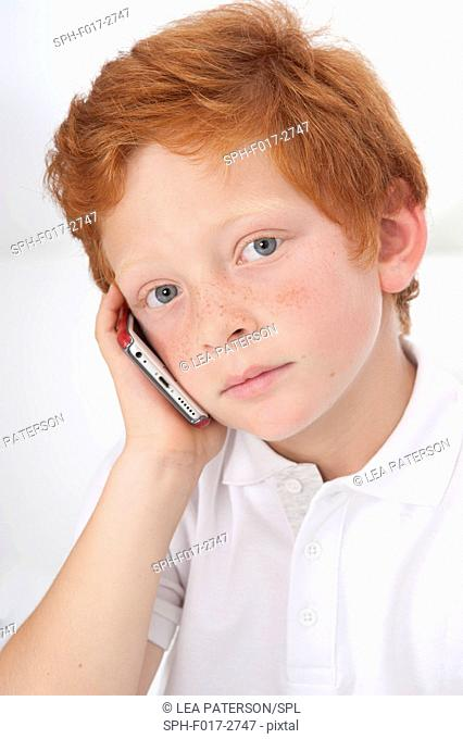 MODEL RELEASED. Boy using cell phone