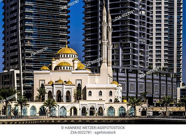 Jumeirah mosque in front of a supertall skyscrapers at Dubai Marina, Dubai, UAE
