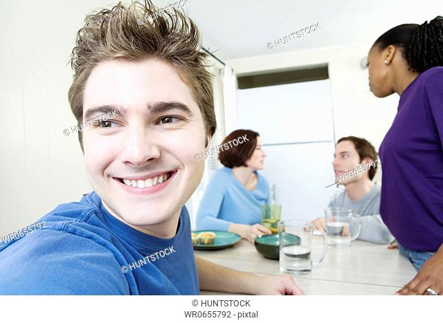Close up of a young man with friends in background