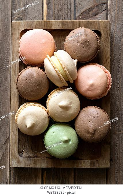 Macarons, a sweet meringue-based confection made with eggs, icing sugar, granulated sugar, almond powder or ground almond, and food colouring