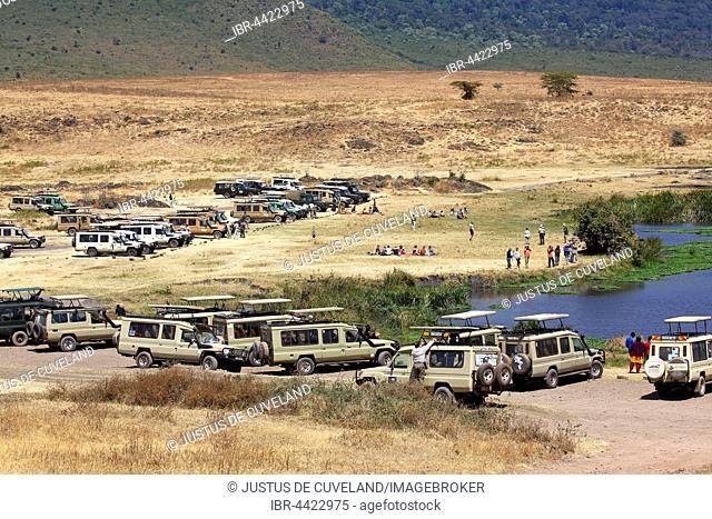 Tourists on safari, ATVs at rest area, Ngorongoro, Serengeti National Park, Tanzania