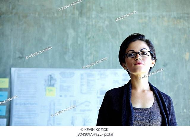 Portrait of serious young businesswoman in office