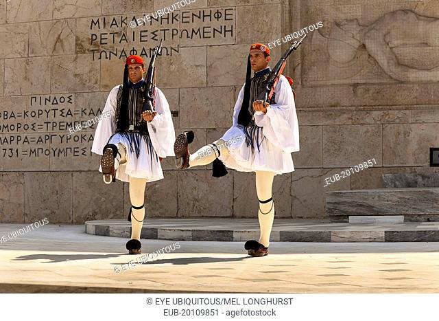Greek soldiers, Evzones, marching beside Tomb of the Unknown Soldier, outside Parliament building