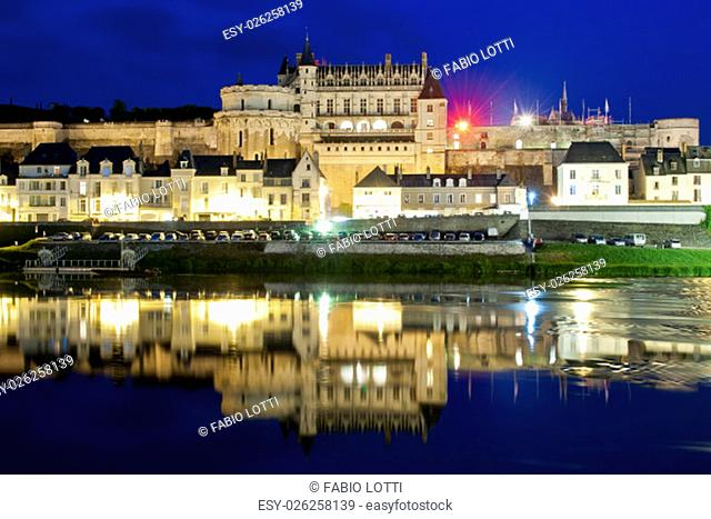 The chateau d'Amboise reflecting in the Loire river, at the blue hour