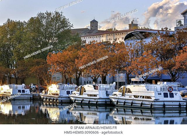 France, Herault, Beziers, Canal du Midi, barges moored in the marina wharf at sunset