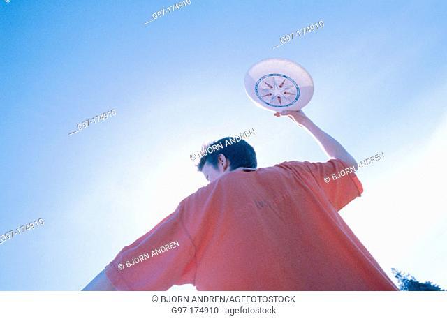 Throwing frisbee
