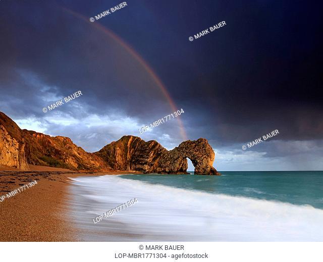 England, Dorset, Durdle Door. A rainbow over Durdle Door in Dorset