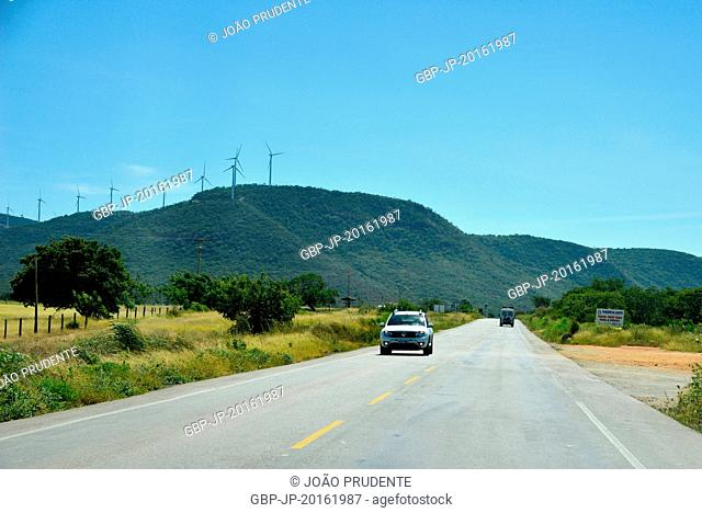 Highway BR-030 with highlight to the wind turbine wind power tower, Guanambi, Bahia, Brazil, 03.2016