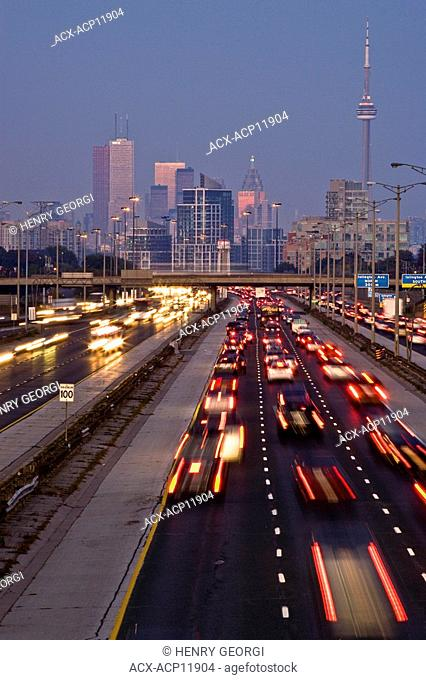 Rush-hour traffic on QEW Queen Elizabeth Way and Toronto city skyline, Toronto, Ontario, Canada