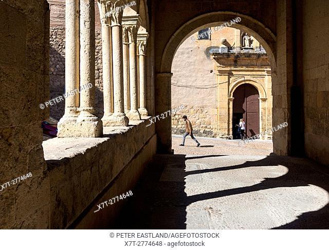 Looking toward The Santo Domingo de Guzman Monastery from the porticoed entrance of Santisima Trinidad church, Plaza De La Trinidad, Segovia, Spain