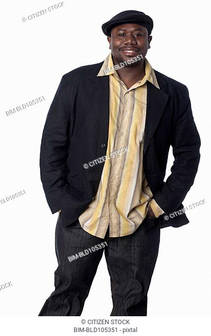 Smiling African American man with hands in pockets