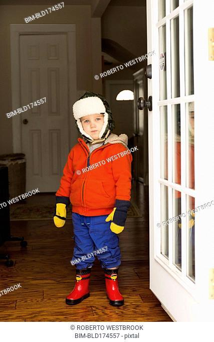 Caucasian boy wearing snow gear