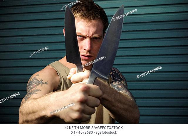 Aggressive 30 year old man with knife