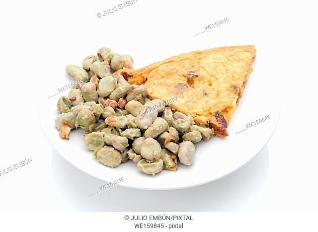 Typical dish combined Spanish beans with bacon and chorizo omelet