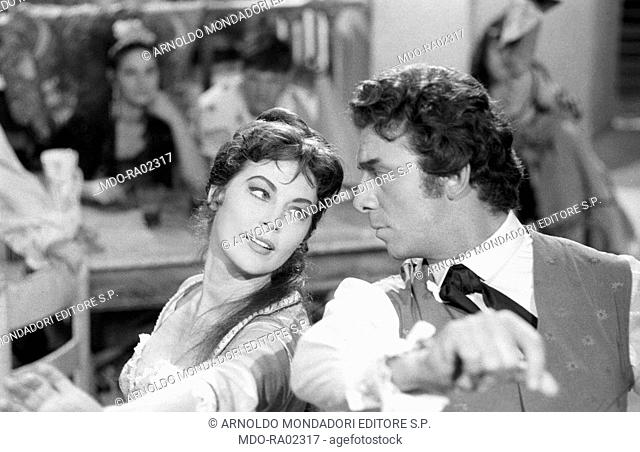 American actress Ava Gardner (Ava Lavinia Gardner) playing the Duchess of Alba Maria Cayetana with American actor and TV personality Anthony Franciosa (Anthony...