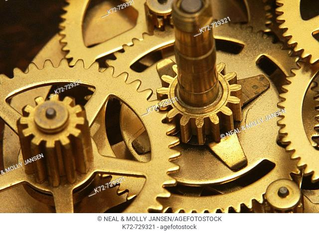 Gears perfectly aligned turn to tell time, run machines and help run the world