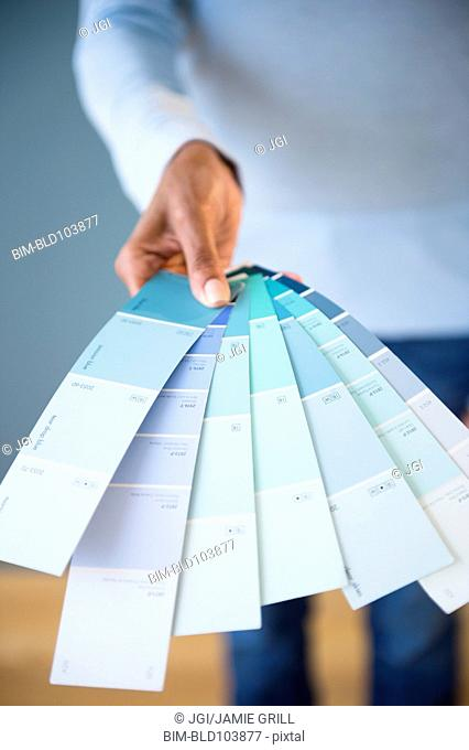Cape Verdean woman holding color swatches