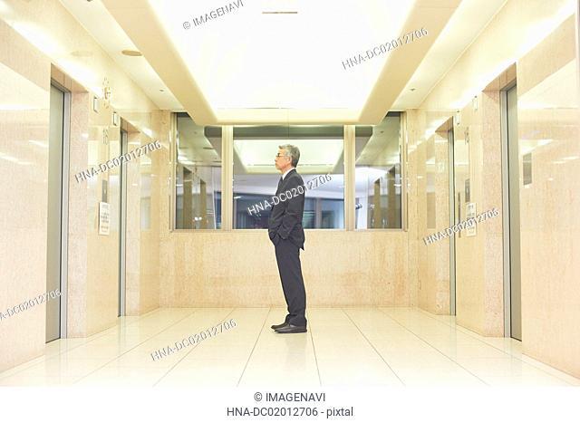 Senior businessman waiting for lift