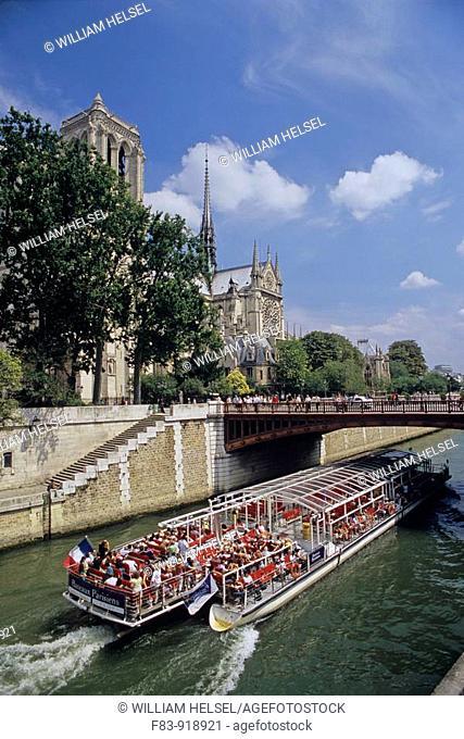 France, Paris, Ile de la Cite, tour boat on River Seine, Notre Dame cathedral, begun 1163