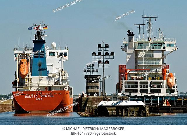 Close-up of container ships chanelling into the Holtenau floodgate, Kiel, Schleswig-Holstein, Germany, Europe