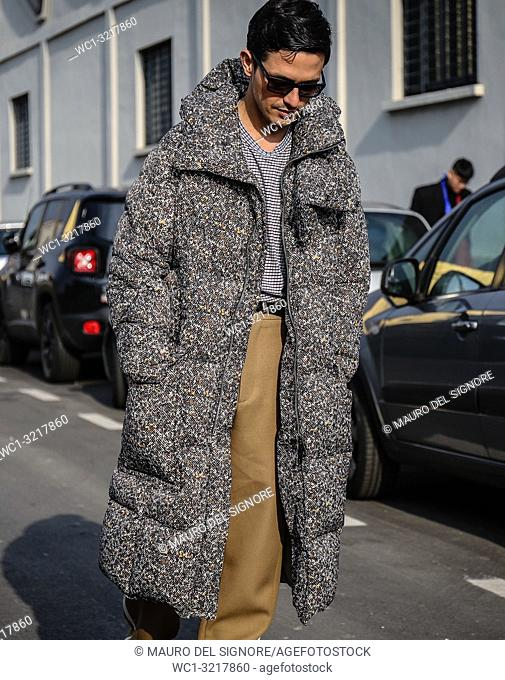 MILAN, Italy- January 14 2018: Alessandro Enriquez on the street during the Milan Fashion Week