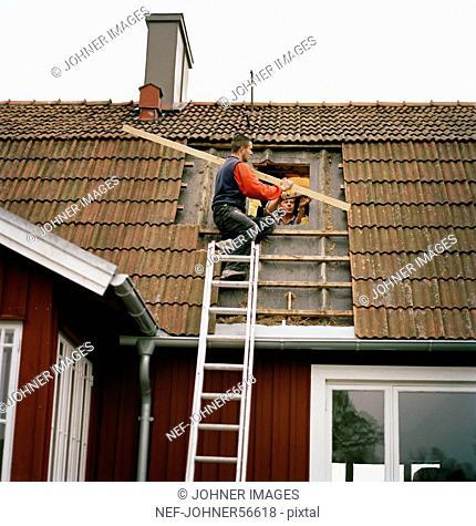 Two men rebuilding a house