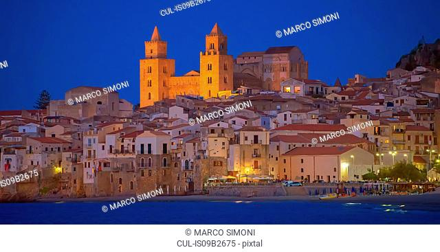 Cathedral San Salvatore and waterfront at night, Piazza Duomo, Cefalu, Sicily, Italy