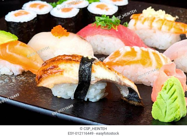 japanese cuisine. sushi set on the background