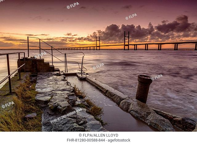 View of jetty and road bridge at sunrise, Sudbrook Jetty, Second Severn Crossing, River Severn, Severn Estuary, Monmouthshire, Wales, January