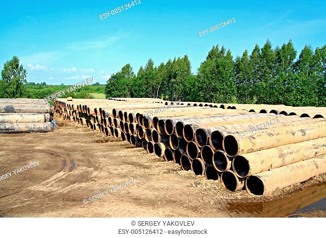 old gas pipes on dirty road