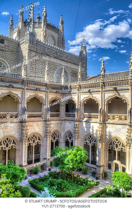 HDR image of the gardens in the central cloister of the Monastery of San Juan de los Reyes in Toledo Spain
