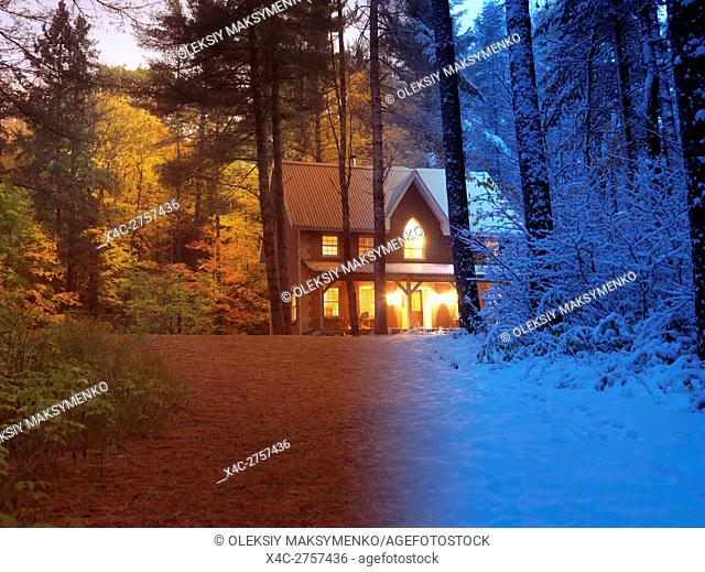 Artistic concept of a country house between colorful fall and snowy winter seasons in a beautiful nature scenery in Muskoka, Ontario, Canada countryside