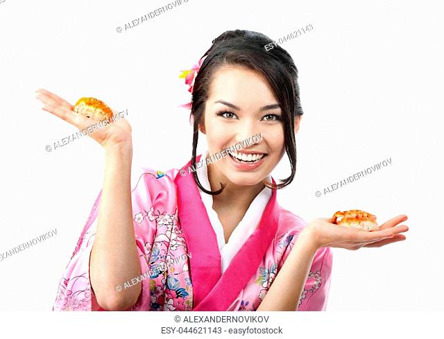 Portrait of the Beautiful Young Japanese Woman Eating Sushi with Two Pairs of Chopsticks, Wearing a Traditional Kimono Dress at the white background