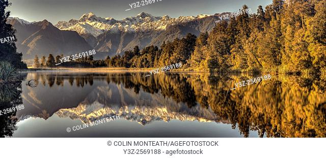 Sunrise, Mt Tasman (left) and Aoraki / Mt Cook reflection, panorama from Lake Matheson, Fox Glacier, West Coast