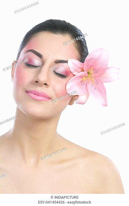 Beautiful woman with eyes closed